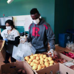 Rutgers School of Medicine student helping bag and deliver groceries to those in need during Covid19 pandemic. Newark NJ